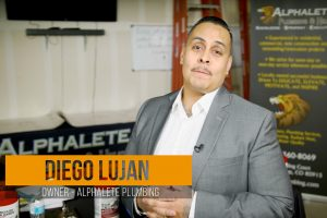 Diego Lujan wearing a suit and looking into the camera